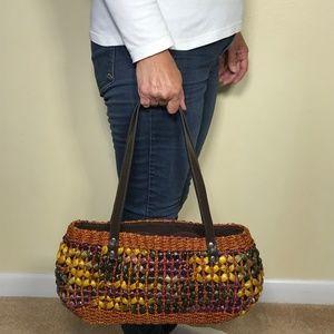Multi colored straw woven purse